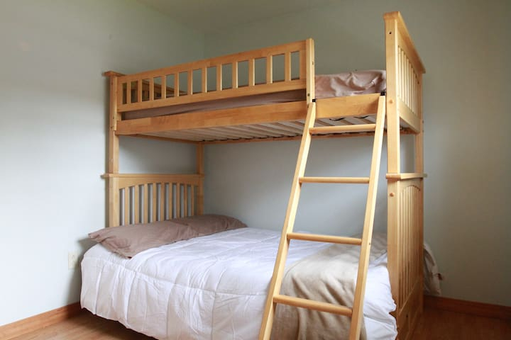 Second bedroom features a single bunkbed over a double bed.