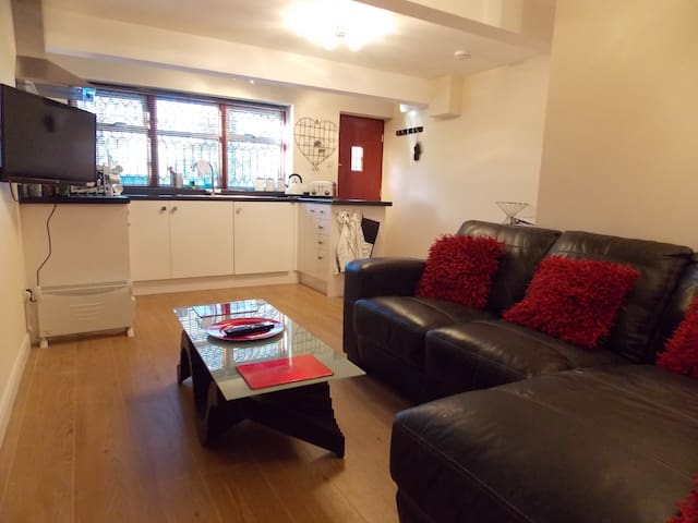Comfy lounge with TV and DVD, luxury fitted kitchen.