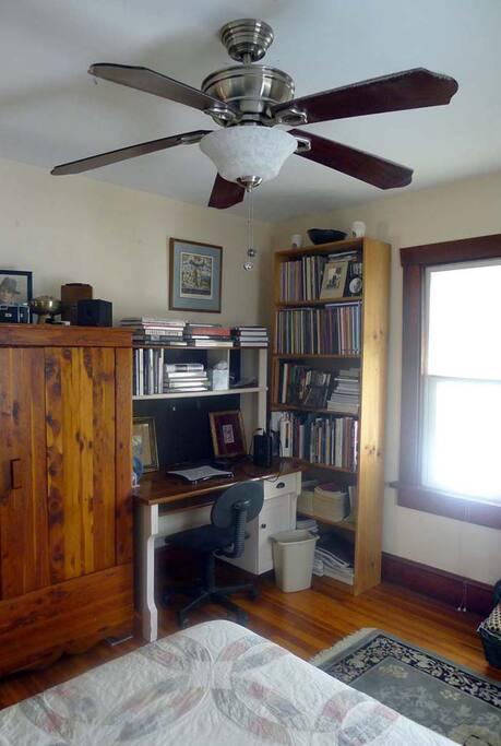 Cedar closet, computer desk, book shelf with art, travel and photography books