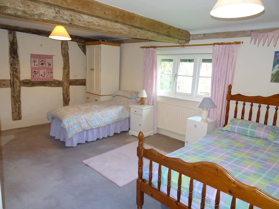 Spacious Room with double & single beds