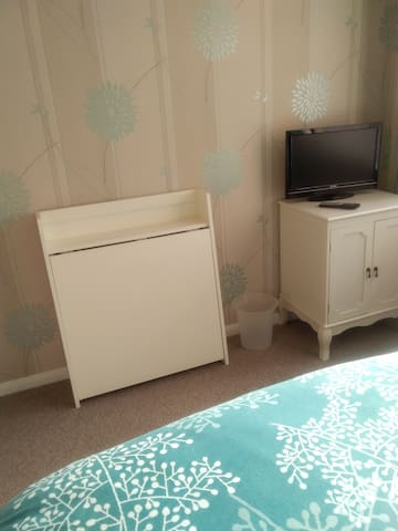 Dining table and two chairs. Freeview tv
