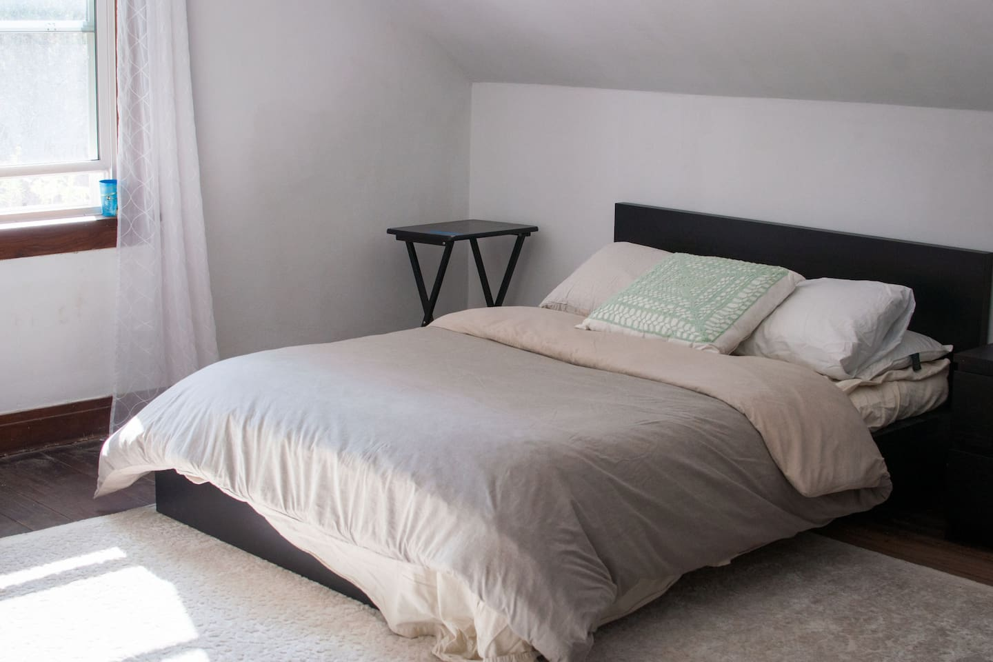 Full size bed in a private bedroom on the second floor.