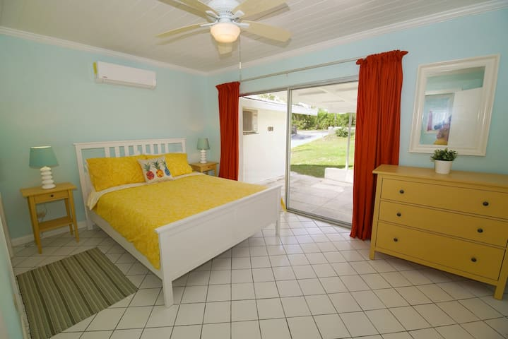Master Bedroom with view to the street and queen bed
