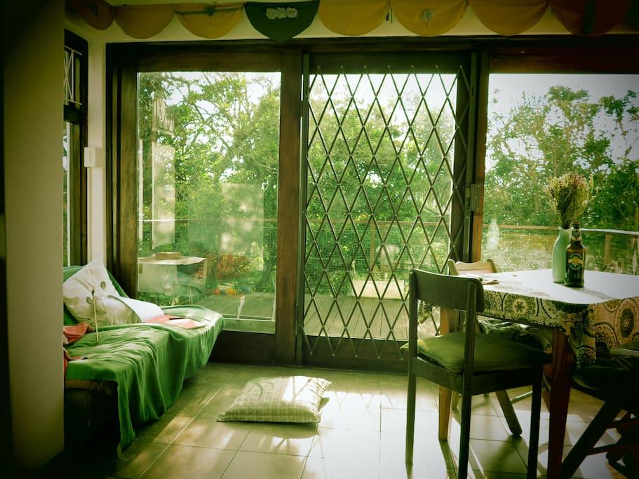 Spaceous sunroom / diningroom verandah in early morning light.
