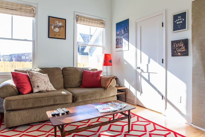 Big comfy couch. Snuggle up to watch TV or read a copy of AirBnB magazine!