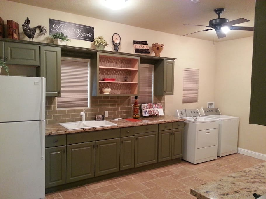Large capacity washer and dryer in kitchen