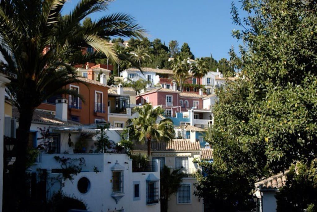 Lovely Andalusian village, the house in middle of picture