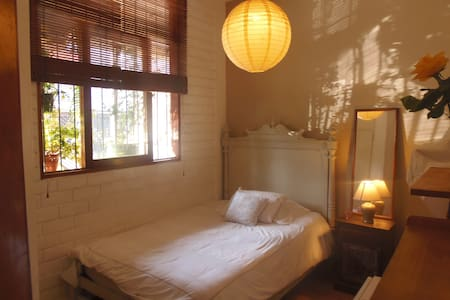 Friendly host offers main bedroom in her apartment, conveniently located in the centre of Miraflores just meters away from the seaside and all amenities.   Tall ceilings, big windows, real bed, lots of light and fresh air.