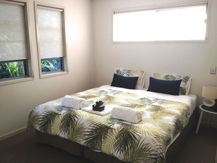 This is the Sunset room in a King bed configuration.  The room has a ceiling fan, built in wardrobe with mirrors, plenty of natural light and fresh linen.  We can split the beds to become two singles or add a third single pull out bed if needed.