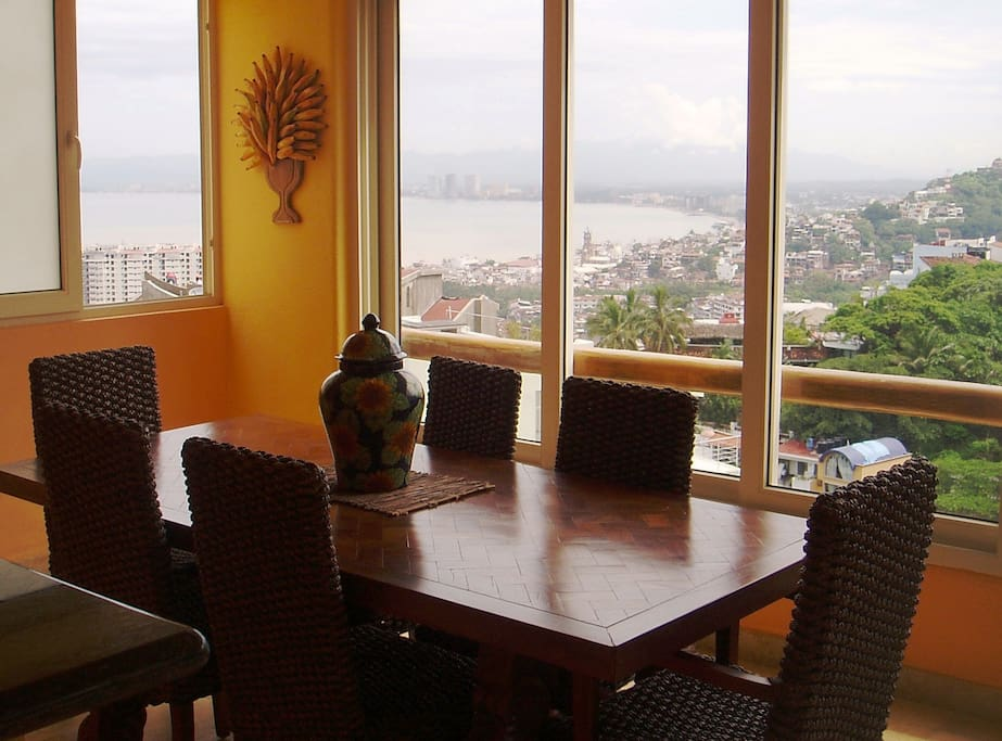 Dinning room with sliding window to open.