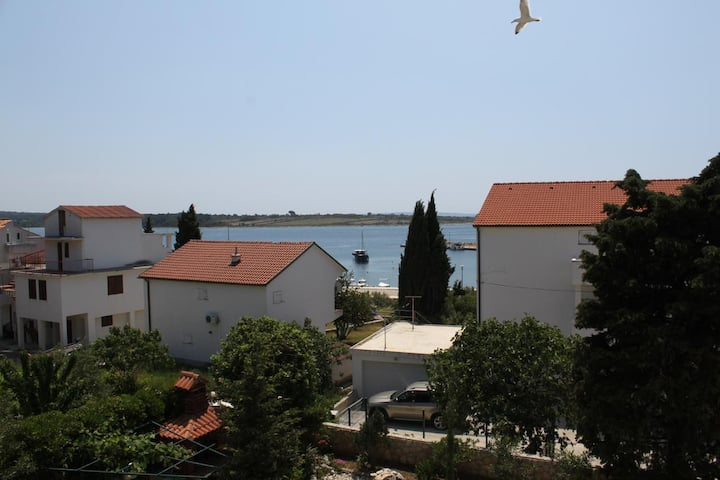 One bedroom apartment with balcony and sea view Novalja, Pag (A-6317-d)