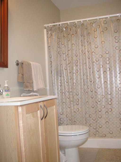 Tiled and spacious private bath with shower.