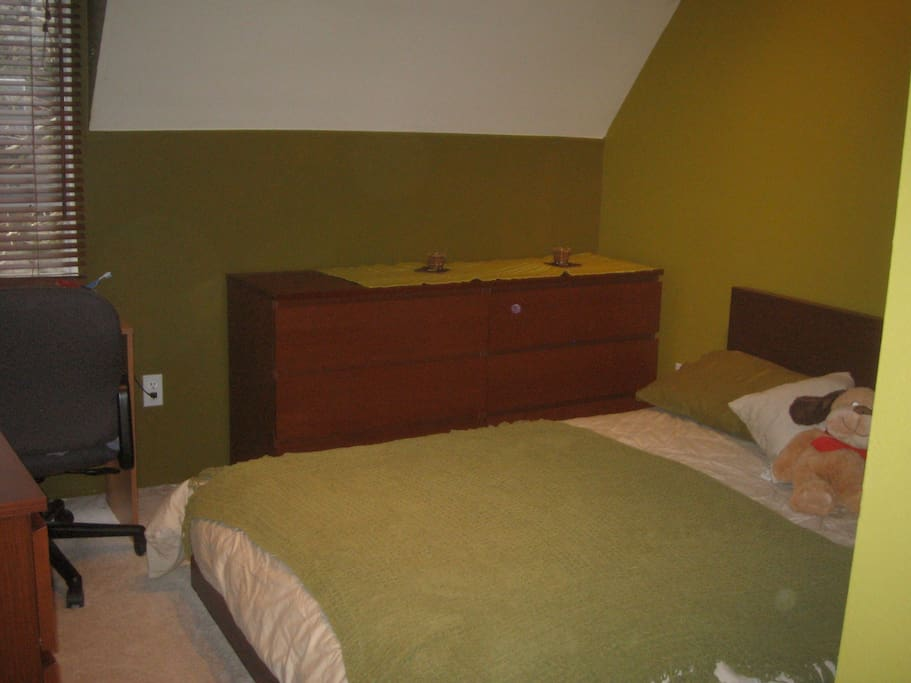 This room has desk, window, Wi Fi, Queen Bed,  storage,  and loft