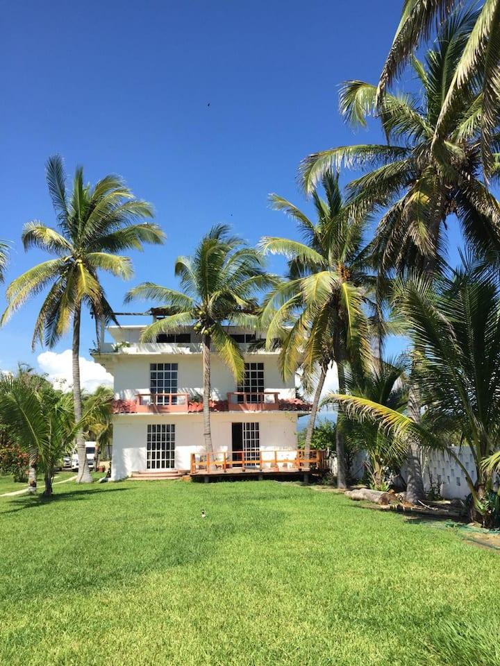 Tu casa frente a la playa Habitación #1