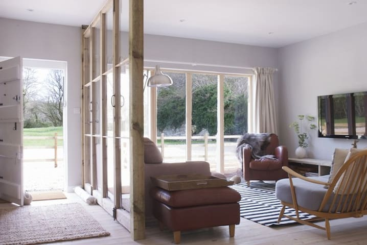 Sun streams into the light airy sitting room