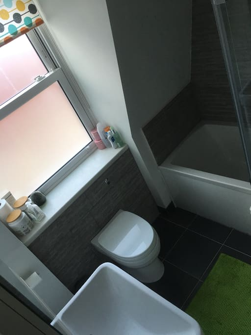 Exclusive use of bathroom with bath, shower, toilet and sink, situated next door to bedroom down a short flight of stairs.