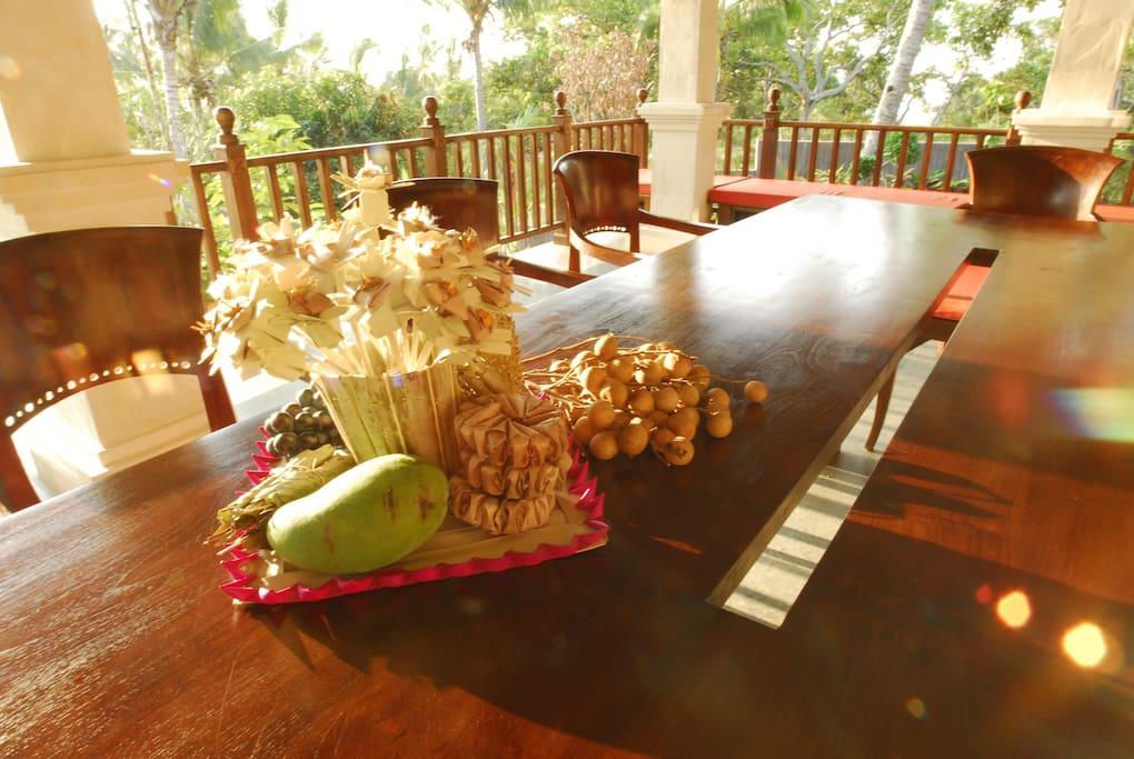 Teak wooden dinner table on veranda