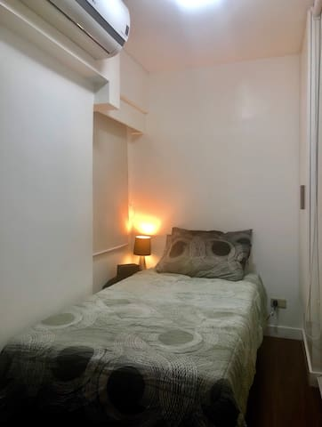 Cozy bedroom with big single bed