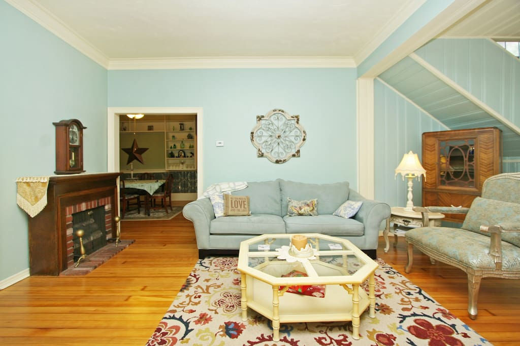 Welcoming Living Room with circa 1800's heart of pine floors.