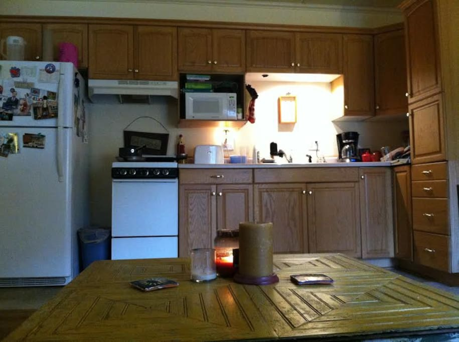 Nice size kitchen with fridge, oven, and stove