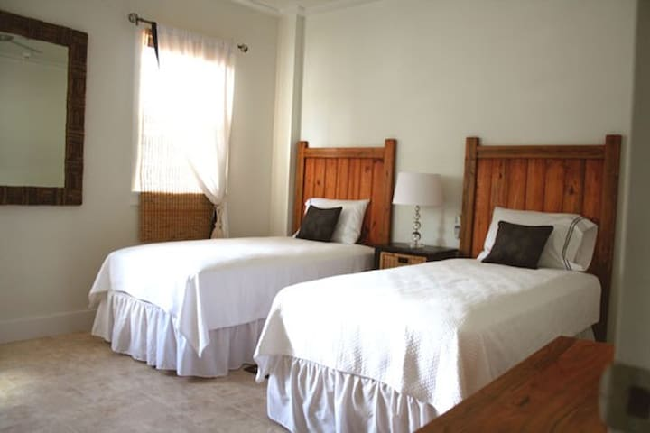 Spacious twin bedroom can be made up as a double or a childs bed added.