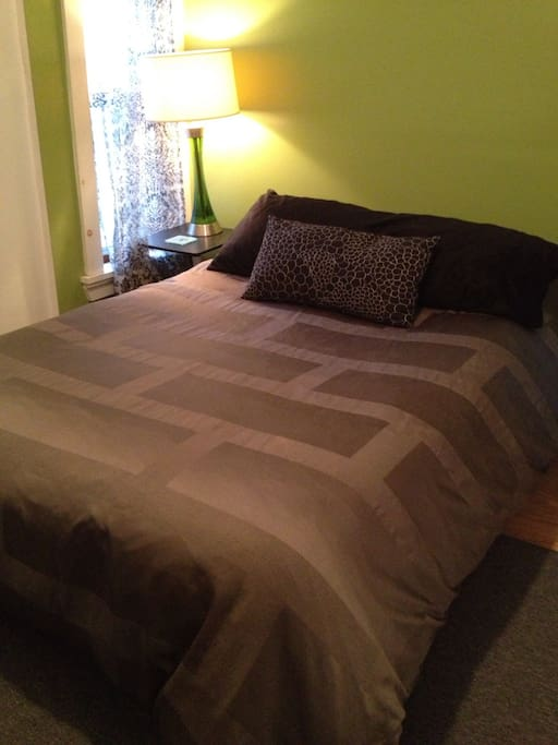 Double platform bed with real mattress, memory foam topper & down duvet.
