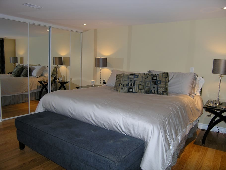 Master bedroom with king sized bed and double clothes closets.