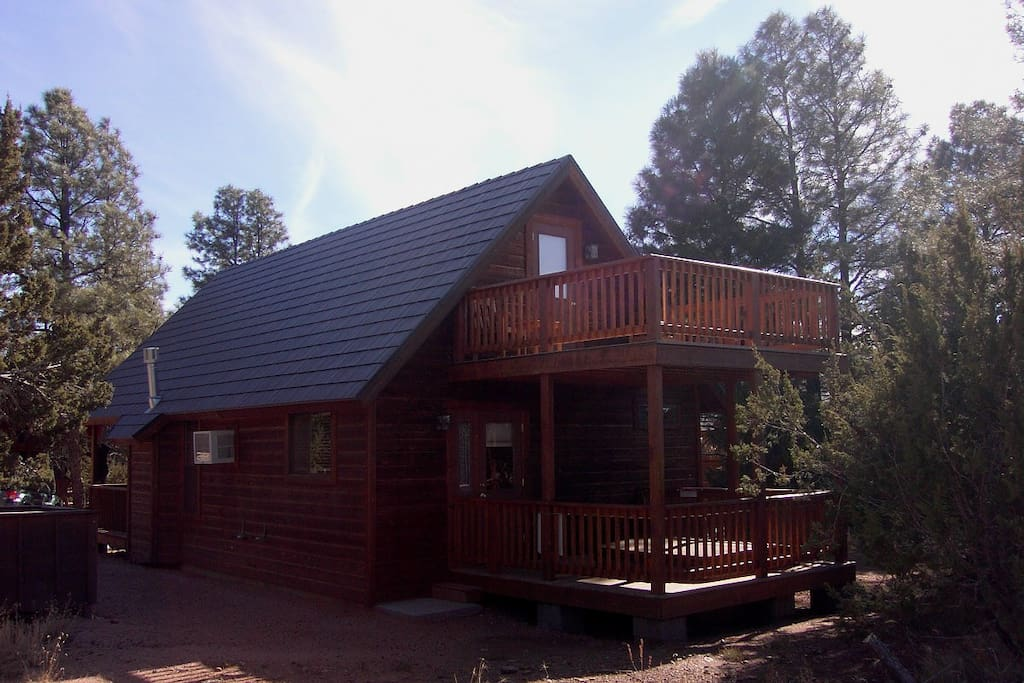 View to the back of the Bear Paw cabin.  Private setting for hot tub on the covered back deck.
