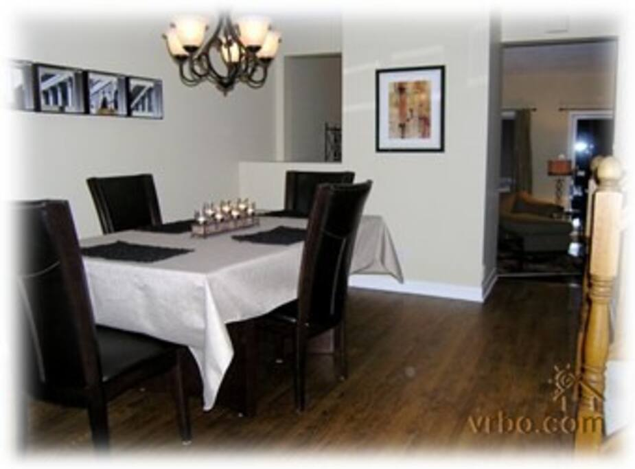 Dining room fully equipped with table ware and linens for six.