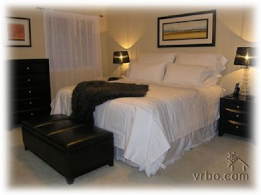 Master bedroom with ensuite, double clothes closets, king sized bed.