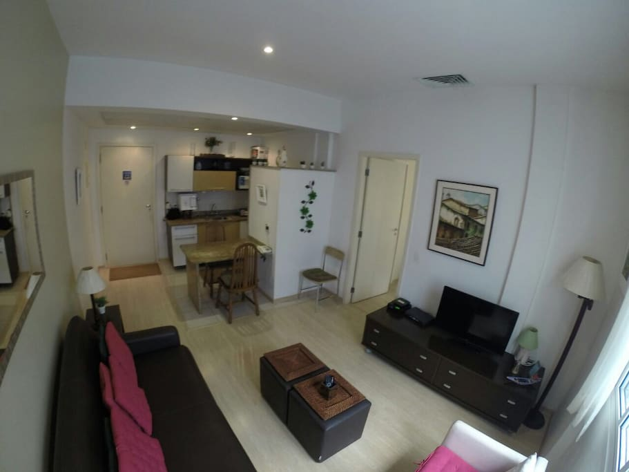 View of living room with kitchenette and door to bedroom