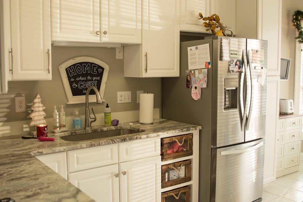 Kitchen newly renovated with brand new granite countertops and stainless steel appliances!