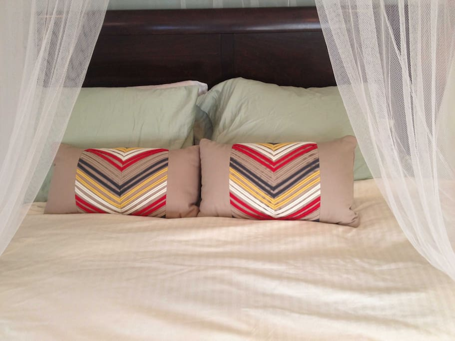 Real down comforter with queen size bed.