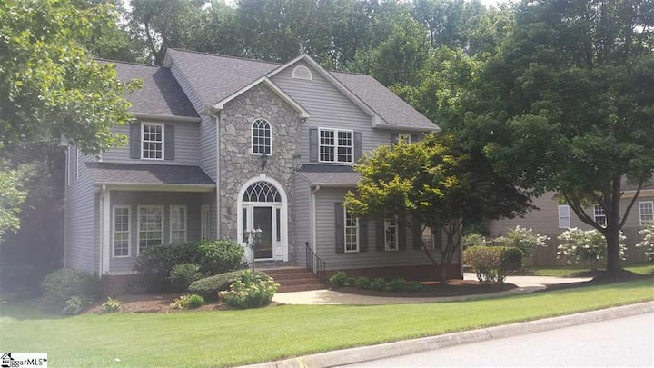 Stylish home with Screened porch, long term only.
