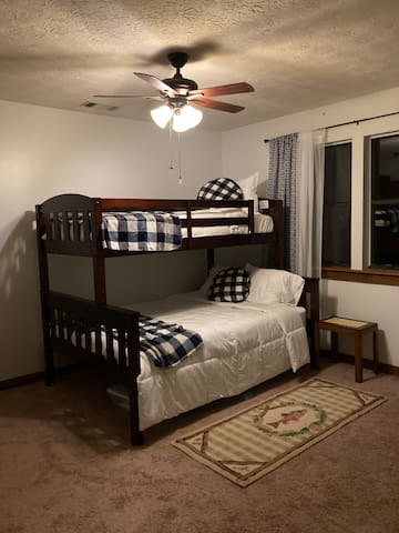Bunk room with full bed on bottom and twin bed on top