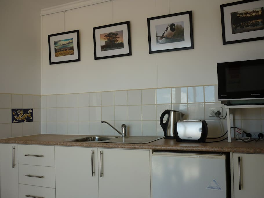 The kitchen is well equipped but there is no stove. There is a gas BBQ on the verandah.