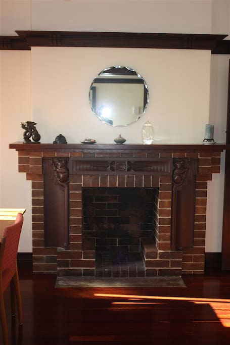 Beautifully carved fireplace in the dining room