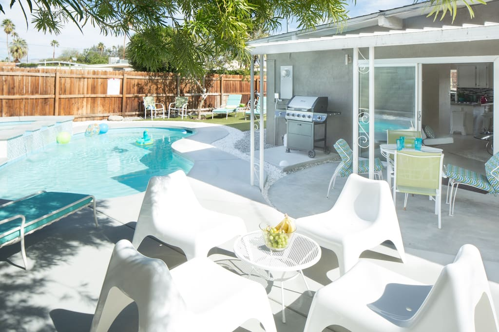 Poolside patio with barbeque and plenty of seating