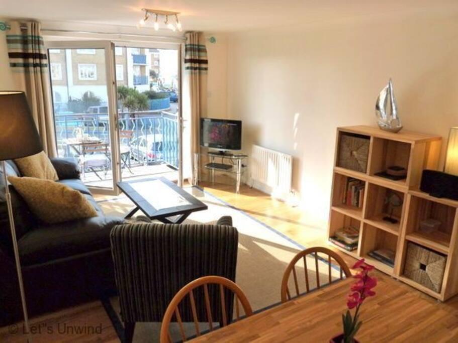 The sunny lounge opens onto the balcony.