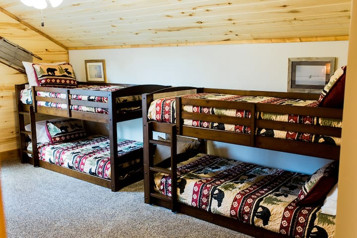 Upstairs bedroom- two bunk bed sets