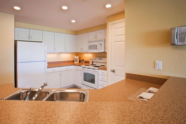 Full size kitchen with dishwasher fridge, stove, microwave and pantry