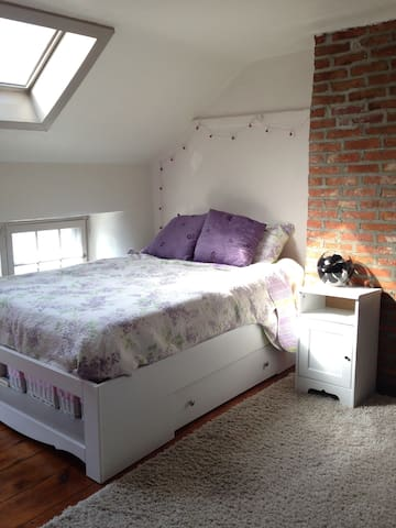 Bedroom on 3rd floor with 2 skylights and memory foam mattress pad.