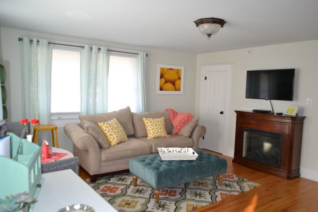 shared living area with fireplace and kitchenette