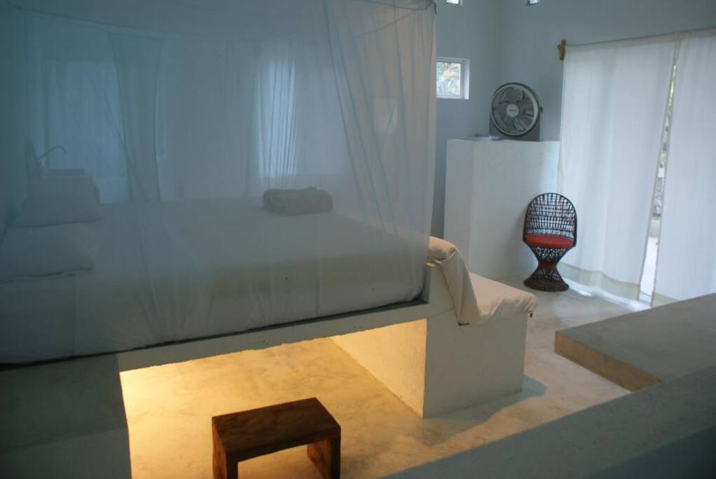 The bedroom is very spacious with high ceilings and  have electricity and fans, a kitchen and hot water.