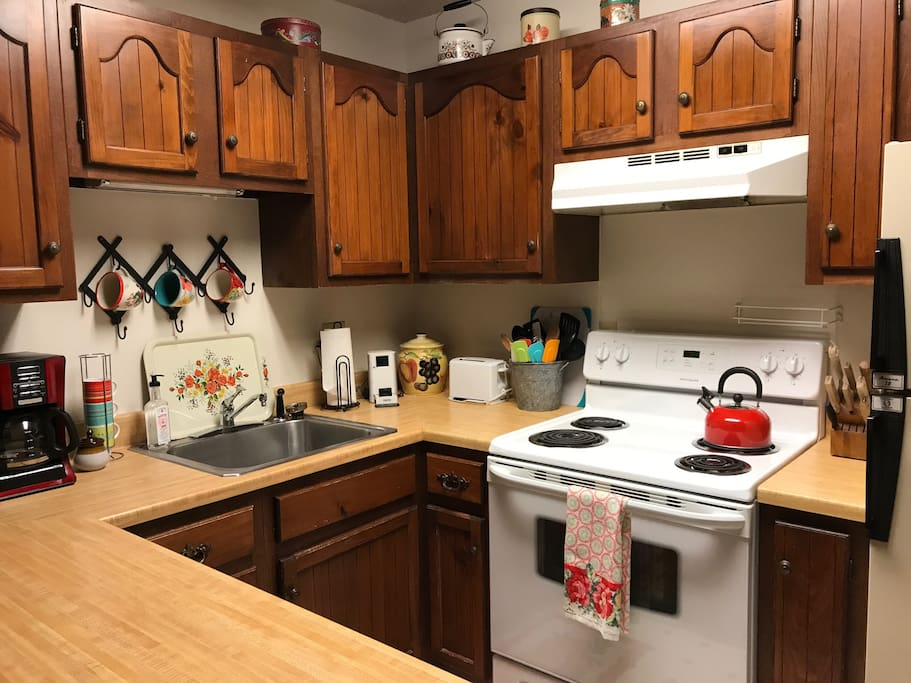 The kitchen is fully stocked with everything you need to cook and enjoy your own meals.