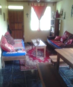 beautiful little house on 5000 square meters of land with a private garden and creek in a beautiful valley between 2 volcanos, great for nature walks and close proximity to tenorio national park and rio celeste hot springs. ideal climate!