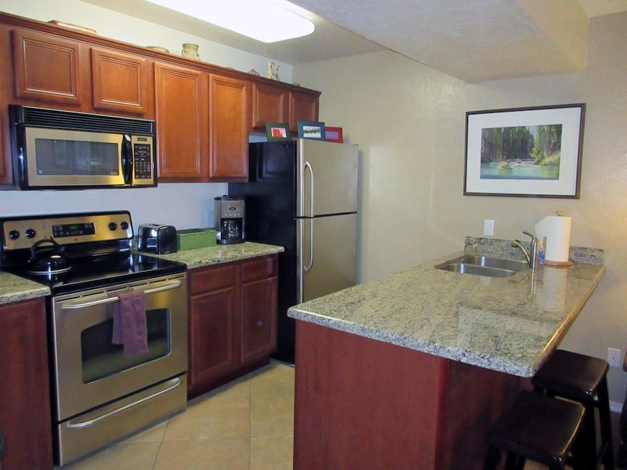 Kitchen with Stainless Steel Appliances and Granite Counter