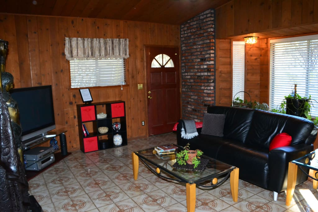 The family room has very comfortable seating for enjoying the large screen tv that has a DVD and CD selection