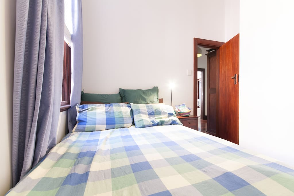 Small bedroom has real double bed, bedside table and cupboards empty for your use.