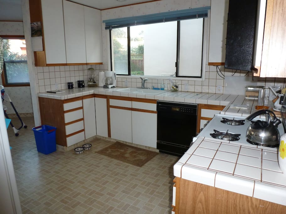Spacious kitchen, with eat in area. Microwave, Refrigerator, dishwasher, garbage disposal, dishes and all cookware